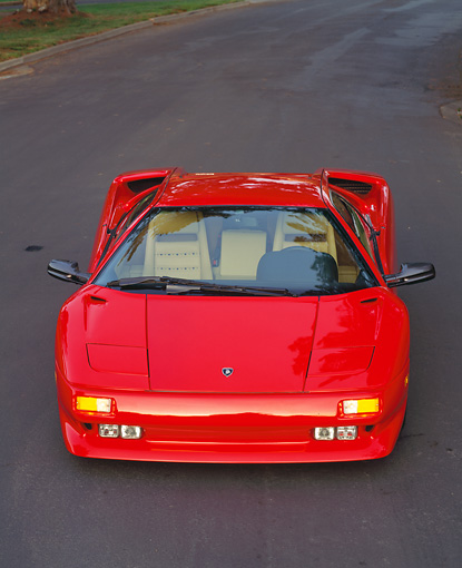 LAM 02 RK0075 12 © Kimball Stock 1991 Lamborghini Diablo Red Overhead Front View On Pavement