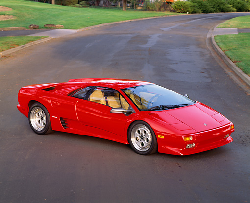 LAM 02 RK0078 09 © Kimball Stock 1991 Lamborghini Diablo Red Overhead 3/4 Side View On Pavement