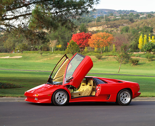 LAM 02 RK0083 04 © Kimball Stock 1991 Lamborghini Diablo Red Front 3/4 View On Pavement