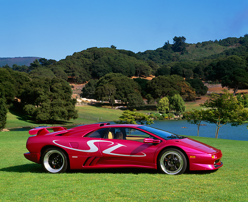 LAM 02 RK0114 02 © Kimball Stock 1998 Lamborghini Diablo SV Custom Purple 3/4 Front View On Grass By Lake And Trees