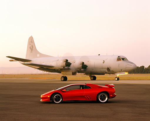 LAM 02 RK0116 01 © Kimball Stock 1998 Lamborghini Diablo SV Red Profile View By Airplane At Dusk