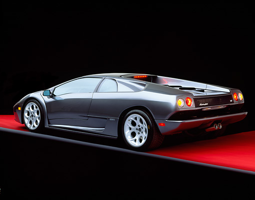 LAM 02 RK0139 06 © Kimball Stock 2001 Lamborghini Diablo 6L Gray 3/4 Rear View On Red Floor Studio
