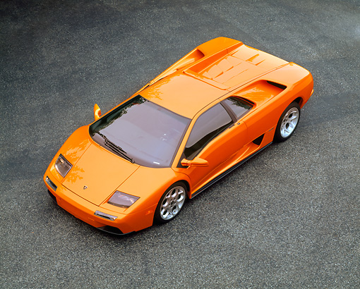 LAM 02 RK0141 06 © Kimball Stock 2001 Lamborghini Diablo  Orange Overhead 3/4 Front View On Pavement