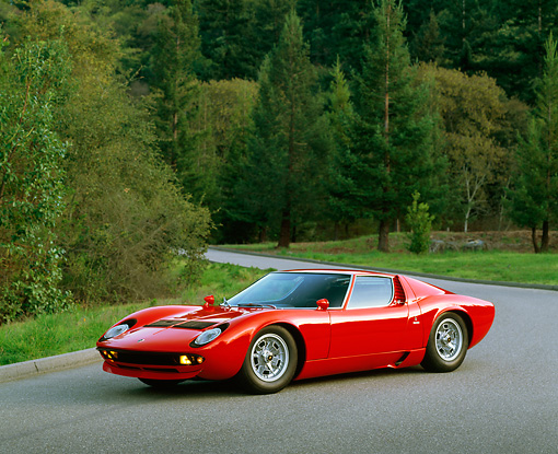 1970 Lamborghini Miura S Red 3 4 Side View On Pavement By Trees