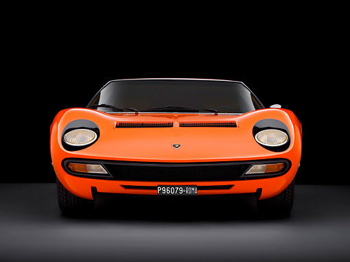 LAM 03 RK0028 01 © Kimball Stock 1972 Lamborghini Miura Orange Head On View Studio