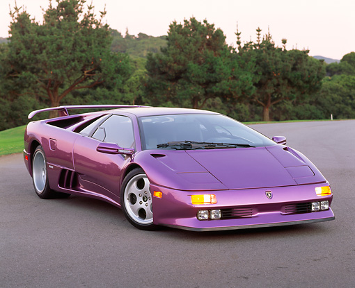 LAM 04 RK0008 01 © Kimball Stock 1994 Lamborghini Diablo 30th Anniversary Edition Purple Front 3/4 View On Pavement By Trees