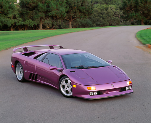 LAM 04 RK0014 05 © Kimball Stock 1994 Lamborghini Diablo 30th Anniversary Edition Purple Overhead 3/4 Front View On Pavement