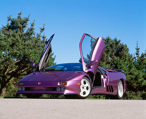 LAM 04 RK0015 03 © Kimball Stock 1994 Lamborghini Diablo 30th Anniversary Edition Purple Low 3/4 Front View On Pavement Blue Sky