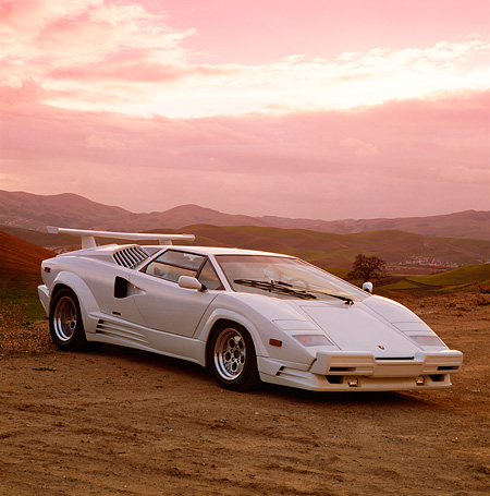 LAM 05 RK0012 05 © Kimball Stock 1989 Lamborghini 25th Anniversary Edition White Front 3/4 View On Sand