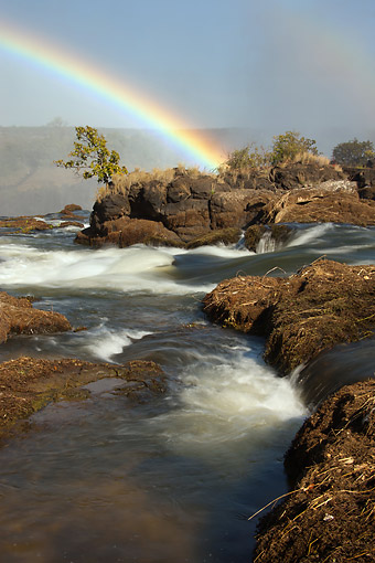 LAN 01 MC0008 01 © Kimball Stock Rainbow Over Victoria Falls In Zambia, Africa
