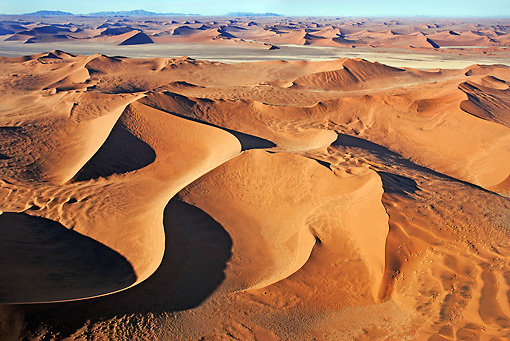 LAN 01 MH0035 01 © Kimball Stock Aerial View Of Red Sand Dunes Namib Desert
