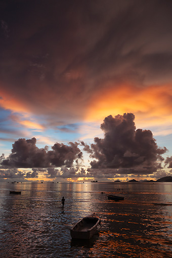 LAN 01 MH0133 01 © Kimball Stock Fishing Boats And Fisherman At Sunset On Secluded Beach In Mahe, Seychelles