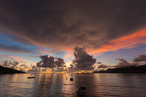 LAN 01 MH0134 01 © Kimball Stock Fishing Boats And Fisherman At Sunset On Secluded Beach In Mahe, Seychelles