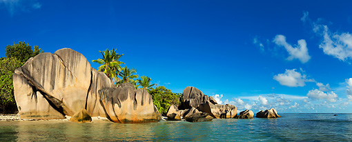 LAN 01 MH0135 01 © Kimball Stock Panoramic View Of Granite Boulders And Coast Of La Digue Island At Anse Source d'Argent Beach, Seychelles