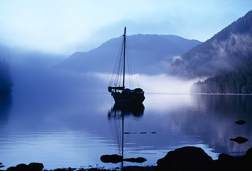 LAN 02 TL0001 01 © Kimball Stock Sailboat Anchored With Mist And Mountains, Inside Passage, Alaska