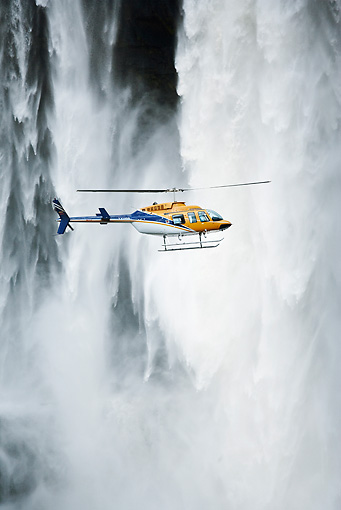 LAN 04 MH0007 01 © Kimball Stock Helicopter Flying In Front Of Aponwao Waterfall Venezuela