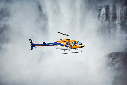 LAN 04 MH0008 01 © Kimball Stock Helicopter Flying In Front Of Aponwao Waterfall Venezuela