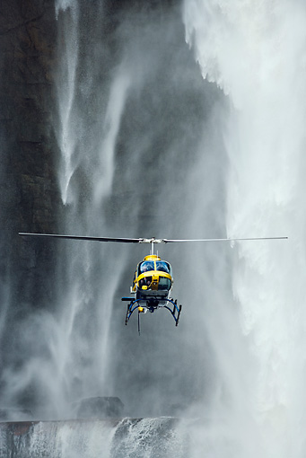LAN 04 MH0009 01 © Kimball Stock Helicopter Flying In Front Of Aponwao Waterfall Venezuela