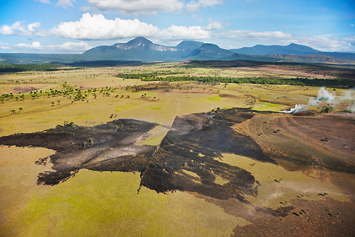 LAN 04 MH0023 01 © Kimball Stock Aerial View Of Gran Sabana And Tepuis With Destroyed Vegetation From Fires