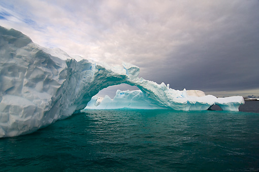 LAN 06 SK0004 01 © Kimball Stock Arched Iceberg Floating In Southern Ocean Off Western Antarctic Peninsula