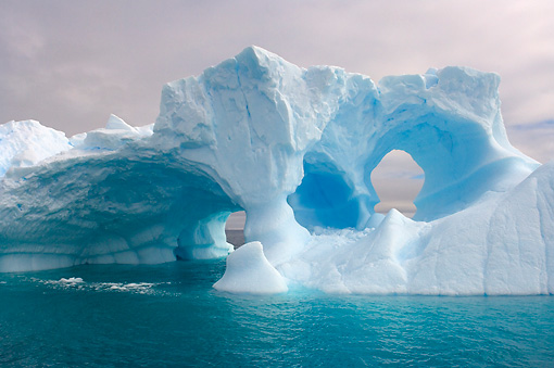 LAN 06 SK0005 01 © Kimball Stock Arched Iceberg Floating In Southern Ocean Off Western Antarctic Peninsula