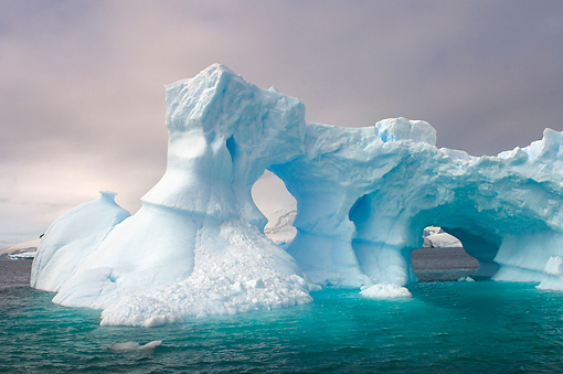 LAN 06 SK0006 01 © Kimball Stock Arched Iceberg Floating In Southern Ocean Off Western Antarctic Peninsula