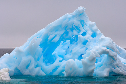 LAN 06 SK0008 01 © Kimball Stock Pinnacle Iceberg Floating In Southern Ocean Off Western Antarctic Peninsula