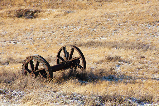 LAN 07 DS0017 01 © Kimball Stock Old Wagon Wheel Laying In Snow Covered Prairie In Montana