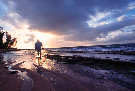 LAN 07 MR0025 01 © Kimball Stock Man Walking On Beach Sunset North Shore Kauai, Hawaii