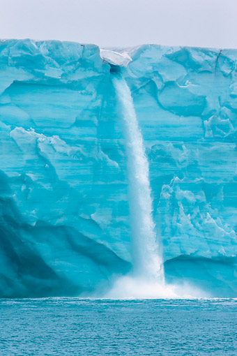 LAN 08 KH0120 01 © Kimball Stock Waterfall On Glacier In Front Of Ice Sheet On Island Of Nordaustlandet Svalbard, Norway