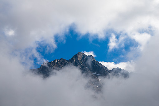 LAN 08 KH0143 01 © Kimball Stock Summit Of Alguille Du Grand Fond In The French Alps View Of Mountain Through A Window Of Clouds