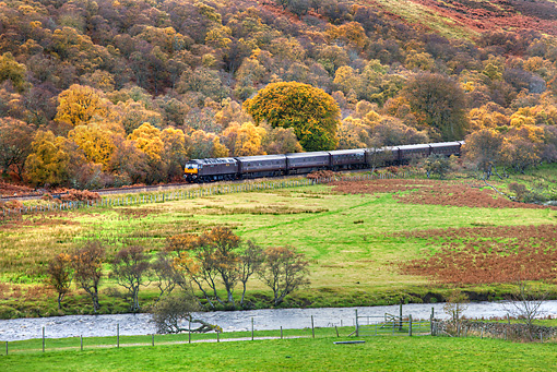 LAN 08 MH0012 01 © Kimball Stock The Royal Scotsman Train Traveling Down River In Scottish Countryside