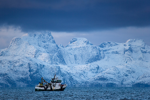 LAN 08 KH0002 01 © Kimball Stock Fishing Boat In Ocean By Snowy Mountains Norway