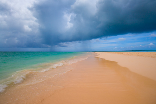LAN 09 JZ0018 01 © Kimball Stock Tropical Beach With Cloudy Sky On Bavaro Beach, Dominican Republic