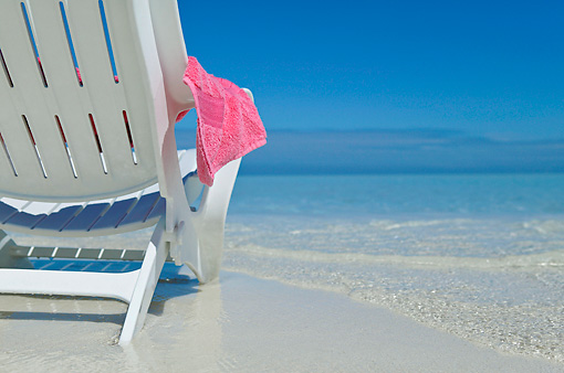 LAN 09 KH0024 01 © Kimball Stock Close-Up Of Lounge Chair On Beach With Pink Towel Maldives