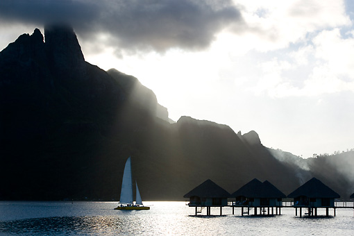 LAN 09 KH0031 01 © Kimball Stock Bungalows On Stilts And Yacht At Sunset Bora Bora