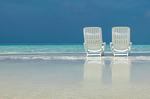 LAN 09 KH0040 01 © Kimball Stock Two Chairs On Beach In Virgin Island Maldives