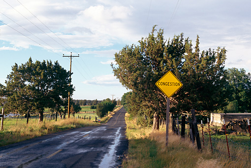 LAN 09 RK0004 01 © Kimball Stock Country Road With Congestion Sign