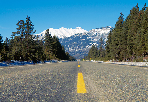 LAN 09 RK0007 01 © Kimball Stock Highway With Snowy Mountains And Forest Blue Sky