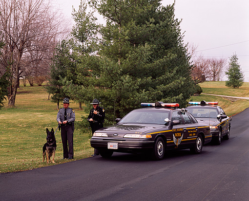 LAW 01 RK0008 04 © Kimball Stock Ohio State Highway Patrol Officers And Police Dog By 1994 Ford Crown Victoria