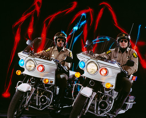 LAW 01 RK0014 07 © Kimball Stock Illinois State Police Officers On Motorcycles Studio