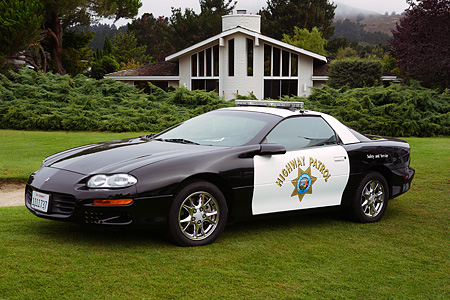 LAW 01 RK0021 01 © Kimball Stock Chevrolet Camaro Police Car Front 3/4 View On Grass