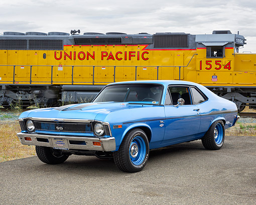 AUT 22 RK3821 01 © Kimball Stock 1969 Chevrolet Yenko Nova SC 350 SS LSX Blue 3/4 Front View By Train