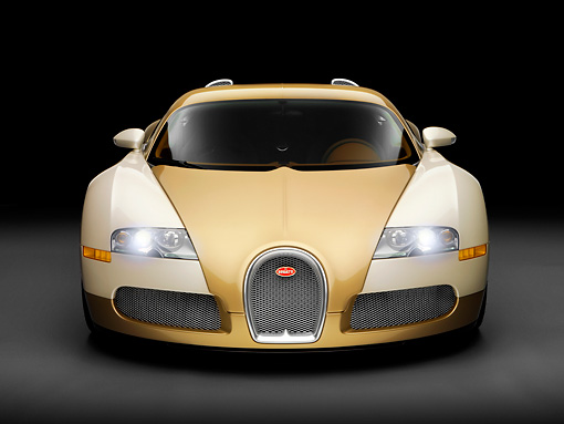 AUT 02 RK0119 02 © Kimball Stock 2008 Bugatti Veyron 16.4 Grand Sport Roadster Gold And White Front View Studio