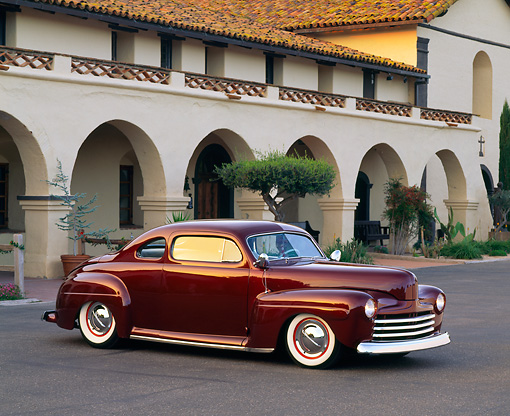 AUT 29 RK0033 02 © Kimball Stock 1948 Burgundy Ford Coupe Special 3/4 Front View On Pavement By Building