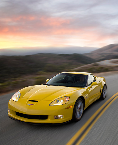 VET 01 RK0905 02 © Kimball Stock 2009 Chevrolet Corvette Z06 Yellow Driving On Highway At Dusk