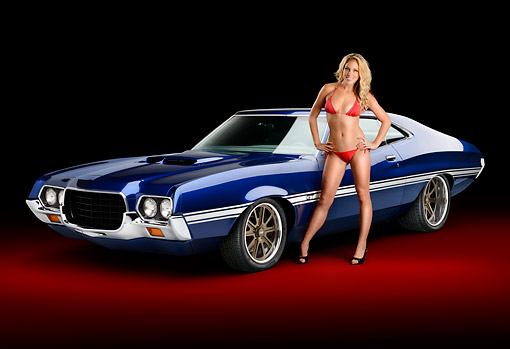 WMN 03 RK0308 01 © Kimball Stock 1972 Ford Torino Blue 3/4 Front View In Studio With Swimsuit Model