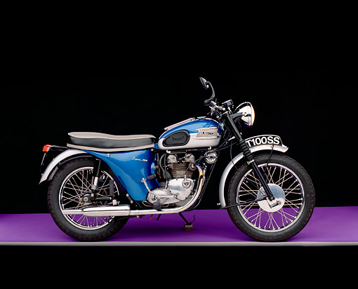 MOT 01 RK0381 01 © Kimball Stock 1962 Triumph T100SS Blue Motorcycle Blue Side View On Purple Floor Gray Line Studio