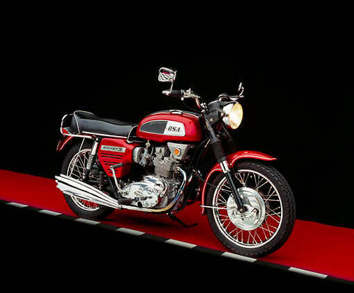 MOT 01 RK0419 03 © Kimball Stock 1969 BSA 750cc Rocket 3 Red Side 3/4 View On Red Floor Checkered Line Studio