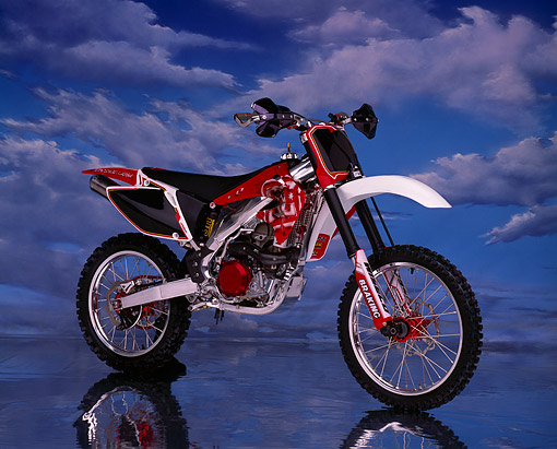 MOT 01 RK0423 01 © Kimball Stock 2003 Honda CRF 450 Motorcycle 3/4 Side View On Mylar Floor Clouds Studio